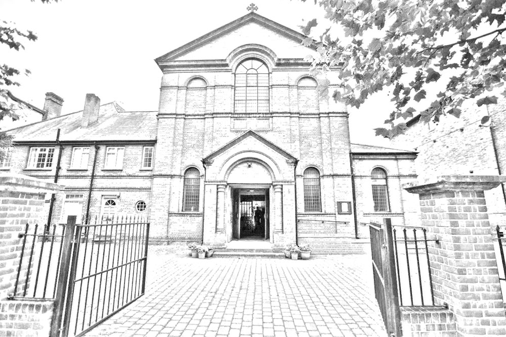sacred heart church front gates and garden